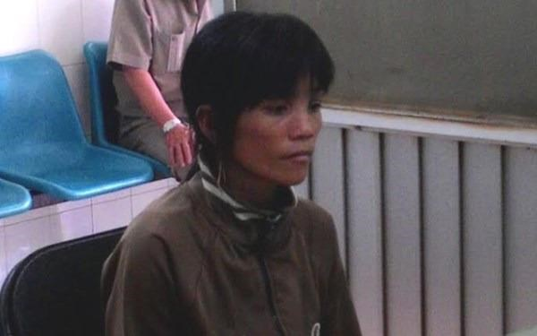Dinh Ngoc Phuong at a police station after she bit bit an officer on his leg, drawing blood November 4, 2014. Photo credit: danviet.vn/Handout by police/danviet.vn