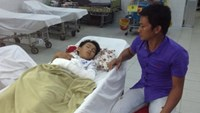 9-year-old Vo Thanh Dat being treated at the Cu Chi District General Hospital. Photo credit: Tuoi Tre
