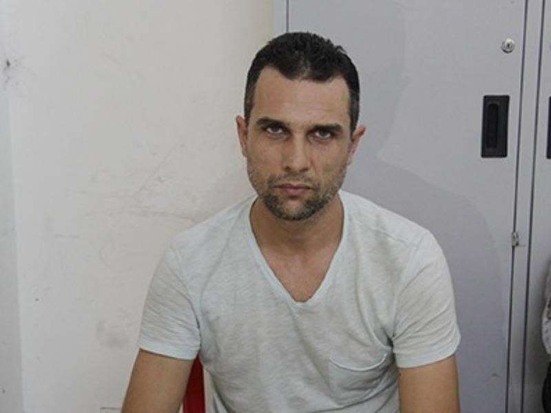 Bulgarian Ivan Slabob Rusev, 37, was arrested for stealing money from ATMs throughout Ho Chi Minh City's District 1 in a single Saturday. Photo provided by the police.