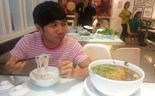 A customer is taking the challenge to finish a giant bowl of Pho at a restaurant in Ho Chi Minh City. Photo: Trung Hieu