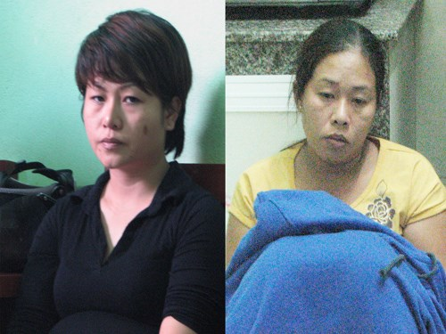 Tran Thi Bich Hang (R) and Mai Nu Le Quyen are arrested while trading 1,959 methamphetamine pills at Hang's house in Da Nang city. Photo provided by the police.