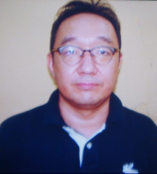 Yang Kyung San, 44, is arrested on September 12, one day after he had relieved a purse from a woman who sat next to him at a dinner party in a Cau Giay district's hotel. Photo: Nam Anh