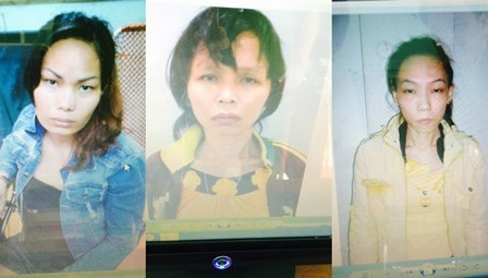 Huynh Thi Ngoc Dung (C), 29, and her two accomplices were arrested for pickpocketing foreign tourists in Ho Chi Minh CIty on Thursday. Photos provided by police