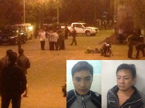 Tran Anh Hung (R) and Phan Duc Dat are investigated for their role in an attack on a police patrol team on Monday night.
