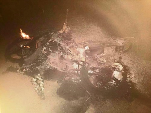 The bike of two suspected dog thieves was burnt out in Quang Ninh province on Friday.
