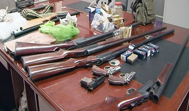 Guns and bullets seized in the bust