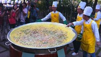 Cooks practice making a giant bánh xèo in Ho Chi Minh City on Wednesday. Photos: Nguyen Nguyen