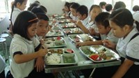 A file photo shows primary students during their lunch time at a school in Ho Chi Minh City.