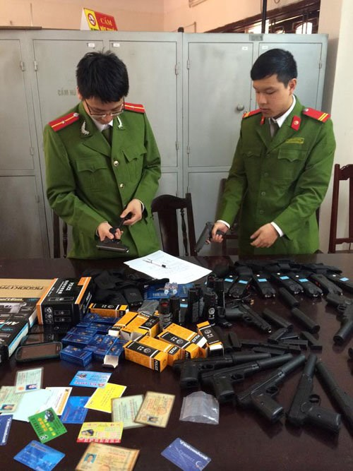 Police in central Vietnam examine illegal goods seized Tuesday from two local men. Photo credit: T.Thanh