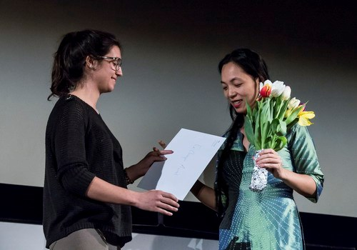 Vietnamese director Nguyen Hoang Diep (R) receives her award from a jury member of the Fribourg International Film Festival on March 28. Photo courtesy by Vu Hoang Diep