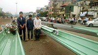 Three men stand beside their super-long motorbikes and trailers in Hanoi on Thursday morning. Photo courtesy of Hanoi police.