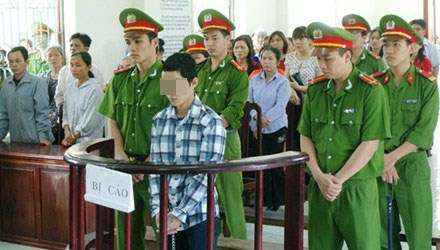 Vu Anh Tu stands in a court house in Thanh Hoa Province on April 3, 2015
