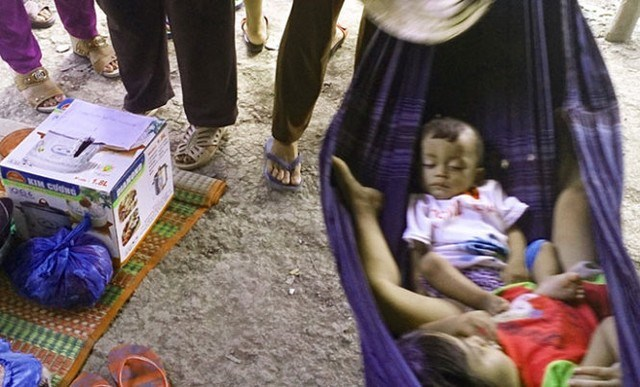 Children of the victims next to a donation box. File photo