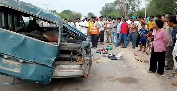 The scene of an accident in which a tourist bus collides with a van in the Cambodian province of Svay Rieng on May 19, killing at least 21 and severely injuring five others. Photo credit: asiancorrespondent.com