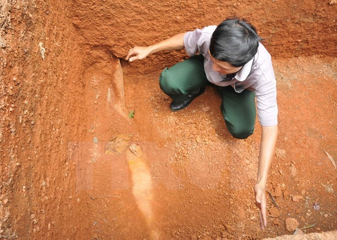 A local official shows the place a US bomb has located for dozenz of years in Binh Phuoc province southern Vietnam. Photo credit: VnExpress
