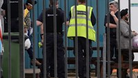 UK authorities found 68 migrants locked in containers aboard four trucks at a port in Essex.