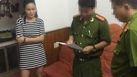 Tran Thi Huong Giang is arrested by local police at her house in Hanoi on Thursday morning. Photo provided by police.