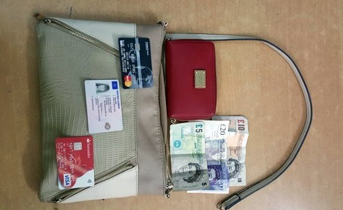 The belongings of a British woman, who was robbed in Ho Chi Minh City on Thursday. Photo courtesy of the police