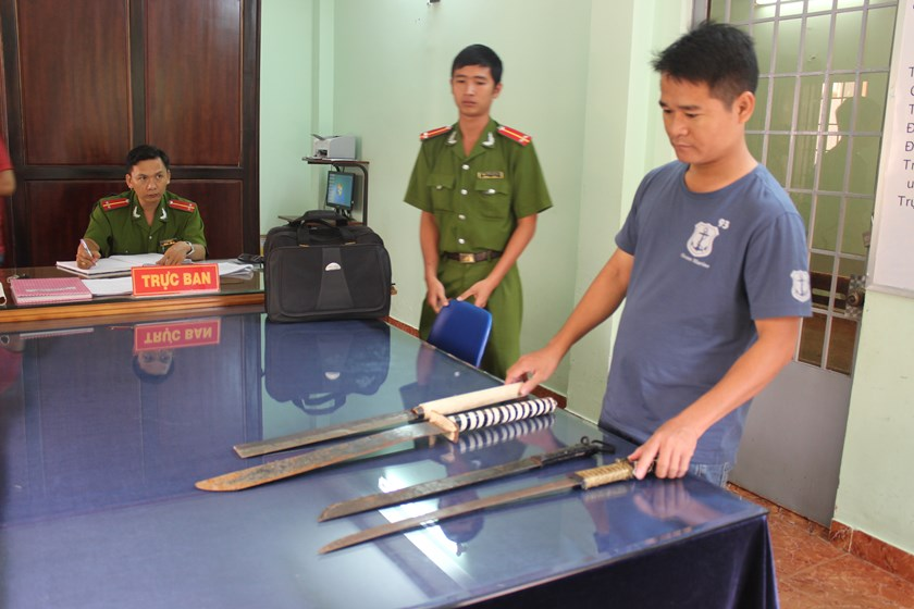 Police seize weapons which are left behind from a massive brawl in Bien Hoa town, Dong Nai province on July 27.