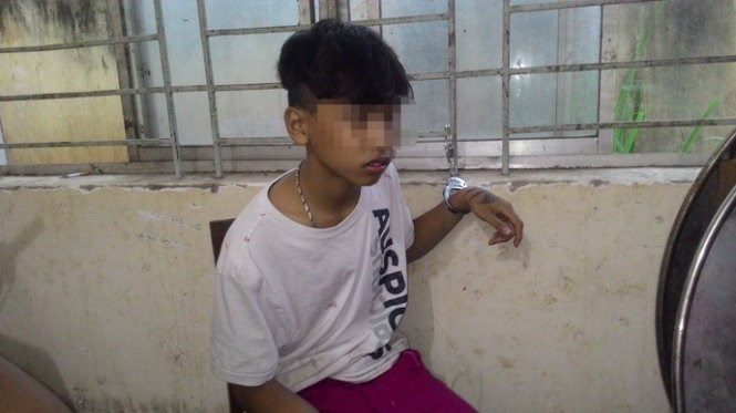 Tran Quoc Hung at a police station in Dong Nai province on Sunday. Photo courtesy of the police.