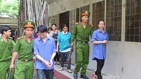 Vo Ngoc Phuong, 42, and her accomplice Lu Chi Hao are taken out of a court in Ho Chi Minh City on Wednesday.Photo: Phan Thuong