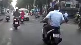 A still photo taken from a dashcam video shows two men on a motorbike before they snatch a necklace from a female driver.
