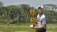 Michael Tran poses with his ADT cup in Jakarta on Saturday. Photo courtesy of MT.