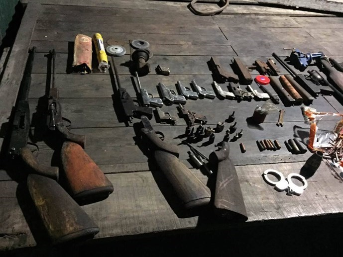 Police seize dozens of homemade guns, grenades and weapon parts at the house of Cao Dang Suu in Quang Ninh province. Photo courtesy of the police.