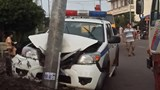 A police car is damaged during a chase after dog theft suspects in Dong Nai Province early Saturday morning. Photo: Trung Nguyen