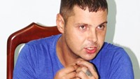Russian suspect Denis Nosov, 27, at a police station in Khanh Hoa province on Friday night. Photo: Nguyen Chung.