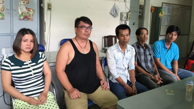 Liu Wei Chun, (second from left), 34, and four of his accomplices at a police station on Sunday. Photo: Dam Huy