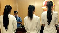Three women stand trial in Ho Chi Minh City on December 30, 2015 for procuring sex services for foreign men. Photo credit: VnExpress.