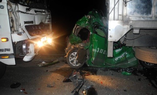 A taxi is crushed between two trucks on a national highway in Vietnam on Friday. Photo credit: VnExpress.