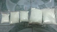 Cocaine and methamphetamine seized at the houses of four drug traffickers in Hanoi. Photo provided by the police.