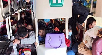 Photo taken inside a 43-seater bus that carries 60 passengers, heading from Nghe An Province for  Ho Chi Minh City on February 13, 2016. Photo: Hue Minh