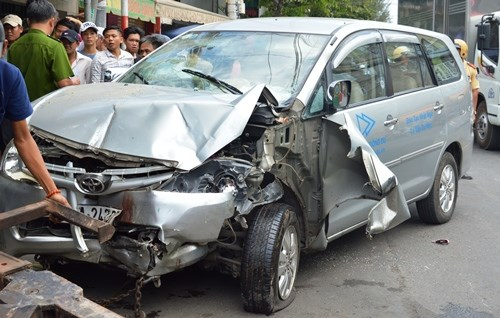 A car is seriously damaged after crashing into a motorcycle repair shop in Ho Chi Minh City on Friday afternoon. Photo credit: VnExpress.