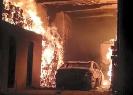Flames engulf a house and a car inside it on Thursday. Photos provided by the home owner
