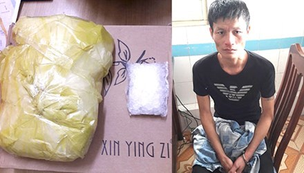 Ngo Van Nam seized with more than a kilo of methamphetamine in Hanoi on Sunday. Photo provided by the police.