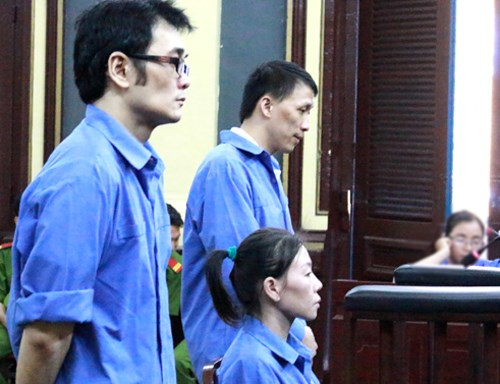 Tran Thi Phuong Long and her two accomplices stand trial in Ho Chi Minh City on March 16, 2016. Photo credit: VnExpress