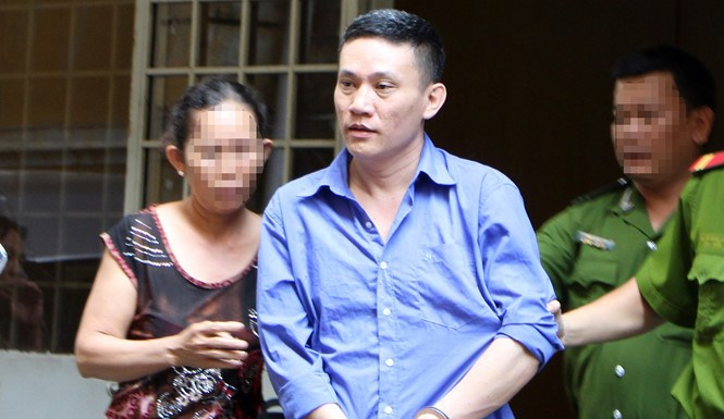 Le Bao Loc, 41, leaves a courtroom in Ho Chi Minh City on March 31, 2016. Photo: Phan Thuong