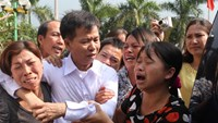A file photo shows Nguyen Thanh Chan (in white shirt) in the arms of his relatives when he was released in November 2013