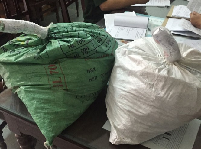 Two bags carrying 47 kilos of explosives that are seized at the Cha Lo border gate, Quang Binh Province. Photo credit: Dan Tri