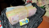 A photo supplied by police shows parts of the VND200,000 forged bills being seized