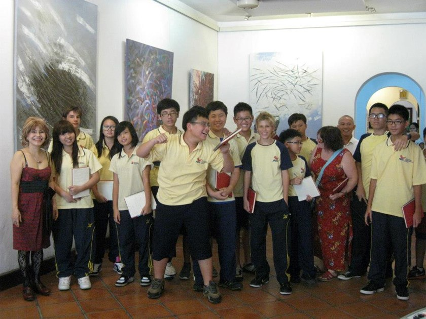 Tu Do Gallery's owner Thu Ha (first from left) with students from American International School during a field trip at the gallery. Photo: Thu Ha