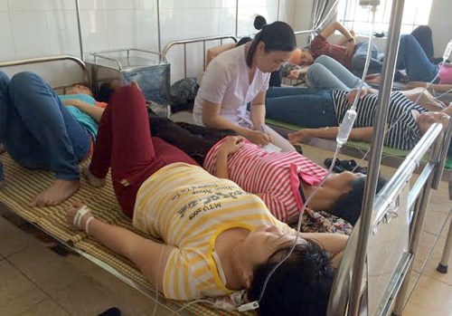 Workers of Nienshing Garment Company being treated for food poisoning. Photo credit: VTC