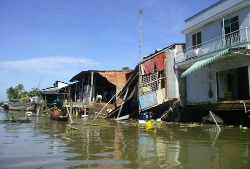 Land erosion kills two, swallows houses in Vietnam