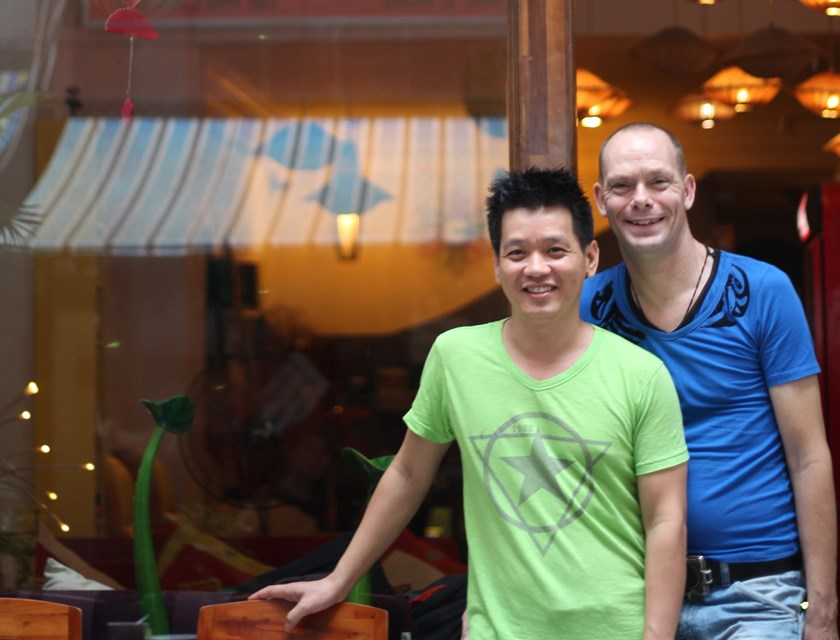 Anne Platt (right) and Nguyen Van Trung were married in the Netherlands in 2008. The pair opened the Pink Tulip, one of Vietnam's first openly gay-friendly hotels, in February of 2013. Photo: Calvin Godfrey
