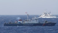 A ship of Vietnam's coast guard (L) operating in the East Sea. Photo: Reuters