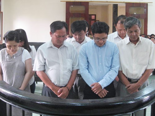 The defendants standing trial for embezzlement in a Swedish-funded project in the central province of Phu Yen. Photo: Duc Huy