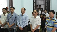 Four former police officials and a local resident standing trial for involving in selling rare wood seized from poachers. Photo: Nguyen Chung